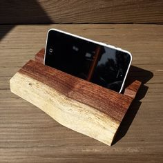 Wifey's iPhone taking the new phone holder for a test run. Perfect for putting on your desk and listening to music or watching videos!  #liveedge #walnut #woodworking #woodworker #DIY #DIYproject #makeauthentic #buildthat