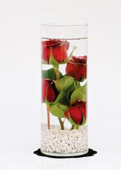 Would do this with one single, red rose and pearls at base of  glass.