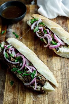 Meltingly tender Balsamic roasted beef shredded into its own gravy, served on a fresh baguette with horseradish cream and quick-pickled onions.