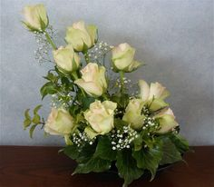 A simple display of roses with babys breath and some ivy from the garden
