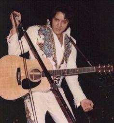 Elvis in concert Atlanta, GA December 30, 1976 Photo courtesy Paul's Elvis Page. Beginning on October 14, 1976 Elvis once again performed on stage with Martin guitars, the same brand as when he began his professional career with his first purchase in 1954 and the last brand he would ever perform with.  This model that he used until Feb 14, 1977 was a 1976 D35 and is most recognizable by its 3 piece back and double non parallel seam bracing visible through the sound hole…