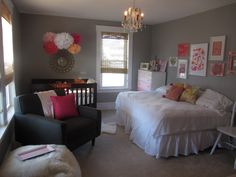 little girl nursery with full-size bed as well as crib.  Love the colors, the pom-poms and the display wall
