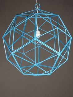 shapely harmony wondering how to add a bit of geometry to square rooms? the bakey street orb light, angled on all ends, adds interest from every perspective. made from the artistic melding of steel pentagons, this turquoise pendant light blends the best of minimalist art with mathematical intrigue. made in the USA.