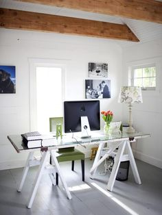 DIY Desk: Salvaged Sawhorses and Door, covered with a sheet of glass. (So easy and inexpensive!) --> http://www.hgtv.com/decorating-basics/clever-uses-for-everyday-items-in-the-home-office/pictures/page-6.html?soc=pinterest