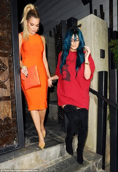 Khloe Kardashian shows off curvaceous figure in a clinging orange number in LA | Daily Mail Online