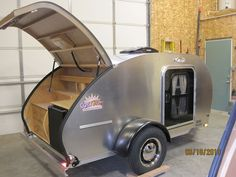 Cozy Cruiser Classic Deluxe Teardrop Trailer The Cozy Cruiser Classic Deluxe takes teardrop camp trailers to a new level. From the built-in entertainment center in the sleeping quarters to the AC/DC refrigerator in the kitchen, this little trailer is big on amenities.