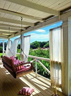 Love porch swings - and love the idea of pull curtains on the porch!