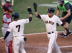 San Francisco Giants' Joe Panik (12) celebrates his two-run home run with Gregor Blanco (7) after Blanco scored in the third inning of Game 5 of the National League baseball championship series at AT&T Park in San Francisco, Calif., on Thursday, Oct. 16, 2014. (Jane Tyska/Bay Area News Group)