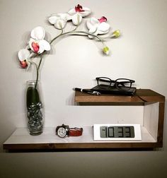Bring character to any space with this unique piece. You can have it as shown or slanted. It can be positioned as shown or upside down (with longer side on top) There are four keyholes cut into the back of the nightstand for easy mounting and it comes with screws and wall anchors.