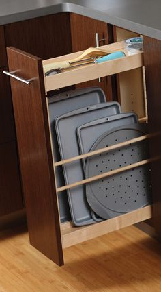 Tray Pull-Out Cabinet from Dura Supreme Cabinetry: Storing #trays, cookie pans and baking sheets in a thin #cabinet pull-out offers a practical and convenient use of a small space. Tray Storage and will no longer be a hassle. The small shelf above also lets you make the most out of the spacing adding a place to store kitchen utensils, measuring cups, spices and other misc. kitchen necessities. – Find more ideas like this at DuraSupreme.com #TrayStorage