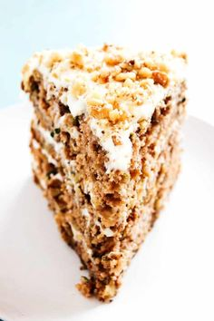 Insanely delicious this BANANA ZUCCHINI CAKE with mouthwatering layers of cream cheese frosting and walnuts; it is one of our family's favorite cakes.