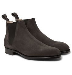 More than a century after Edward Green opened its workshop in Northampton, the method of construction used for its shoes remains largely unchanged, reflecting an impressive consistency of vision. These 'Camden' Chelsea boots are crafted from rich dark-brown suede that will complement a multitude of smart and casual looks alike. Supple leather linings and elasticated sides ensure a comfortable wear.