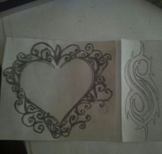 The left one was a tattoo idea for my step sis she found that i drew and if course the slipknot symbol i was gonna do in my thigh...