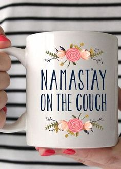 "I don't know about you, but ""namast'ay on the couch."" Sip your coffee on the couch in this adorable mug made of a durable white ceramic. Want this mug in a bigger size? It is also available in our 15o"