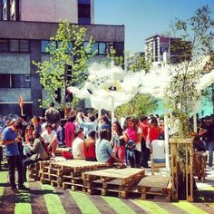 Santiago, Chile: Pop-up plaza. A few coats of paint, pallets and a canopy made from paper cups.  A street is transformed into a community gathering spot. Creating an enhanced fabric of life. Terrific! PopUpRepublic.com