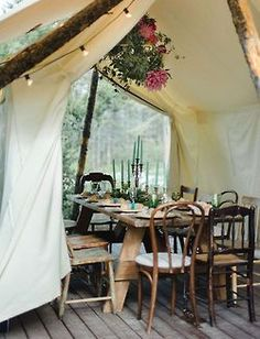 Simple dining under a natural tent + floral chandelier