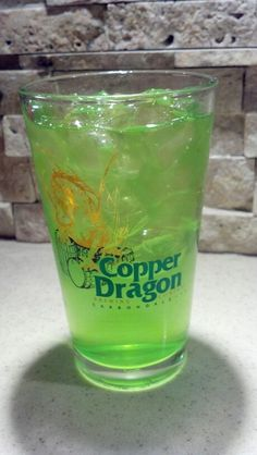 A Copper Dragon Green Dragon.  Carbondale IL.  SIU.  Southern Illinois University  Mix: 1/2 oz triple sec 1/2 oz light rum 1/2 oz gin 1/2 oz vodka 1/2 oz tequila 1 oz sweet and sour Fill the rest with Midori Melon liqeur   Shake with ice  Hold on to the ground cause the world is about to lose its hold on you.