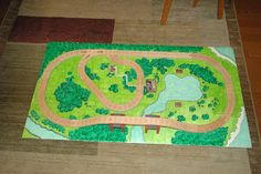I wouldn't use cardboard, but very cleverly done.  Mom's Daily Adventures!: DIY Train Playboard Tutorial (for wood trains)