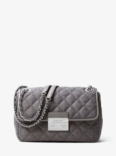 91f001bd00e18 Our Sloan bag combines luxe quilted felt with a chain-trimmed shoulder  strap to form one haute handbag. Tempered by modern hardware and a  structured ...