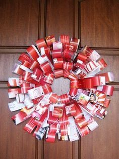 Homemade Christmas Decorations: Magazine Wreath | Childhood101  Kids can make a new wreath every year. It keeps them busy and feeling that sense of pride for contributing to preparations for Christmas.