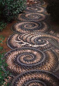 Love the starfish and waves  Swirl pebble mosaic path.