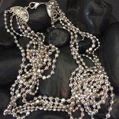 Vtg multi strand silver beaded necklace Vintage long mulistrand gorgeous silver metal beaded necklace. This necklace features 5 strand of beautiful metal silver beads.  Very elegant. Vintage Jewelry Necklaces