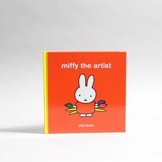 Miffy The Artist By Dick Bruna: Miffy takes inspiration from a visit to an art gallery and decides to become an artist herself. Looking at the colour and shapes of the world around her she discovers what fun it can be to make pictures of the things she sees. By bedtime, her walls are full of all her wonderful artworks.  - The perfect gift for a budding artist, this is a charming book from one of the master illustrators of our time. - 32 pages - Hardback