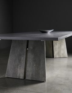 InteriorArt's Cracked Cement high pressure laminate on base of Tuohy Tables