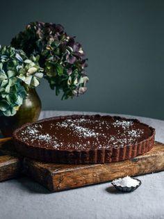 Dark Chocolate Tart with Sea Salt. maybe try with a white chocolate glaze Tart Recipes, Sweet Recipes, Dessert Recipes, Sweet Pie, Sweet Tarts, Slow Cooker Desserts, Cupcakes, Chocolate Desserts, Chocolate Tarts