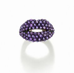 Lavishly decorated with tiny amethyst cabochons, @solangeazagury vibrant edition to the Hot Lips ring collection has our seal of approval as a style icon for 2016. Have you ever seen such a luxurious and dramatic pout? #hotlips #iconic #ring #luxury #jewelry #pout #amethyst
