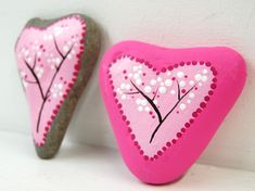 These heart shaped stones/rocks/pebbles have been painted with outdoor paint from DecoArt (a weather resistant acrylic  that can be used on concrete, terracotta, wood, masonry, stone, rocks, pebbles and more).