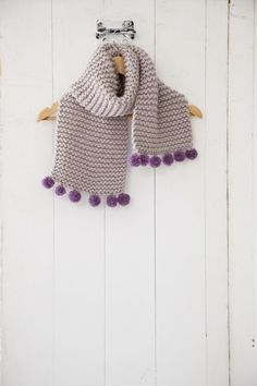 Keep warm whilst looking incredibly stylish with this knitted pompom scarf in issue 1 #SimpleStylishKnitting
