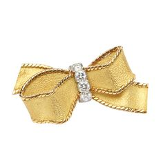 1960s Cartier Gold Diamond bow pin | From a unique collection of vintage brooches