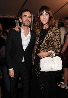 Designer Marc Jacobs and Alexa Chung attend the Marc Jacobs Spring 2013 fashion show during Mercedes-Benz Fashion Week at N.Y. State Armory on September 10, 2012 in New York City.