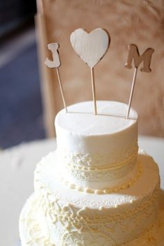ivory lace wedding cake with wooden cake toppers // photo by LauraMurrayPhotography.com