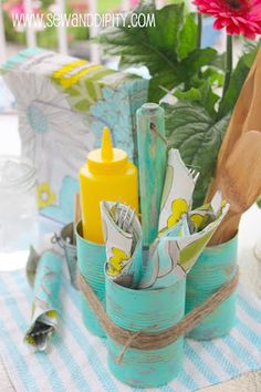 Recycled soup cans caddy, love the turquoise & twine!