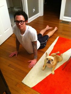 "Trivium's vocalist Matt Heafy doing Yoga with his Frenchie ""Miyuki""."