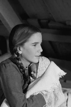 Laura Ingalls with a baby.