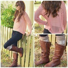 Pink knit top, dark jeans, boot socks.
