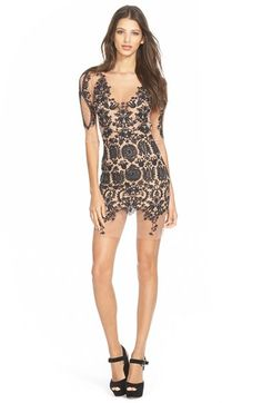 Free shipping and returns on For Love & Lemons 'Lotus' Sheer Embroidered Minidress at Nordstrom.com. Intricate embroidery creates a spectacular illusion on a sheer minidress lined with nude stretch fabric. A daring open back ties behind the neck to complete a look that's sure to turn heads and drop jaws.