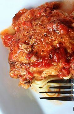 Crockpot Red Wine Chicken Cacciatore - bone in chicken smothered in a garlic, red wine, tomato sauce and served over linguine!