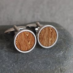 A lovely pair of round cufflinks featuring our popular woodgrain effect.  These cufflinks are carefully handmade for you in our Brighton studio. The wooden discs are laser cut from reclaimed British wood, and the woodgrain effect is laser etched onto the surface.  These cufflinks are the perfect gift for a style conscious friend and come beautifully gift wrapped in a gift box and tied with ribbon.