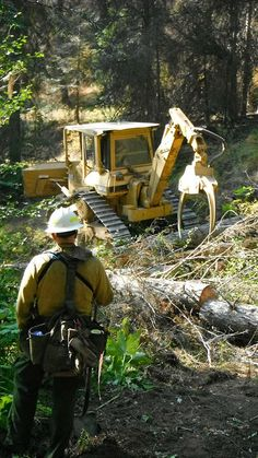 Heavy Equipment on Table Mountain Fire A firefighter watches as heavy equipment…