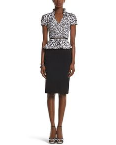 c3ceda6ed9 The put-together look of a feminine blouse and straight black skirt in one  well-paired piece. Silky top features a geometric leaf print