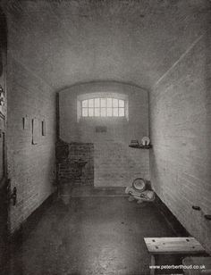 A Cell in Newgate Prison c. 1890s.  Since 1858, the prison had single cells. Below the window is the water basin, the bed is rolled up in the right corner.