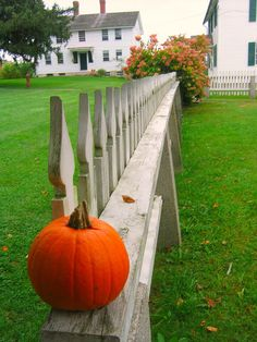 the fence around the Meeting house looking the the Ministry Shop on the right and the Children's Shop straight ahead; Canterbury Shaker village, Canterbury, New Hampshire.