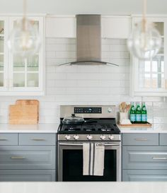 Inspiring Kitchens You Won't Believe are IKEA: two-toned cabinets