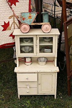 Mini- mine was similar but not drawers on bottom and no cabnit doors on top- mine painted bright yellow