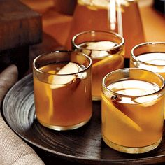Apple-Brandy Hot Toddy Ingredients: 1 1/2 cups water 2 tablespoons plus 2 teaspoons honey 1/2 cup fresh lemon juice 2 cups apple brandy, preferably Calvados Eight 3-inch cinnamon sticks Directions: In small saucepan, bring the water to a boil...