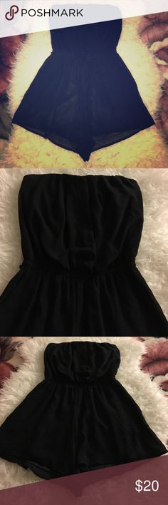 Silky Black Romper Bought it and realized it should have came with a belt. I although still wore it without the belt. Perfect fit ! :) has two pockets iris Other